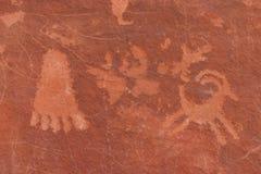 Écriture indienne indigène sur la roche Photos stock