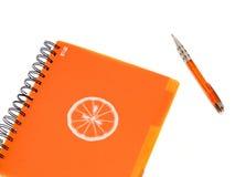 Écriture-livre orange photographie stock libre de droits