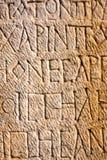 Écritures découpées par pierre Photo stock