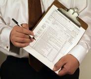 Écritures d'impôts Photos stock