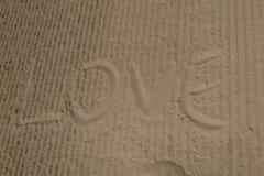 Écrivez l'amour sur la plage, message d'amour Photos stock
