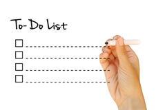 Écrivez la liste de remue-ménage Photos libres de droits