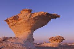 Écrivez la roche dans le lever de soleil Photographie stock