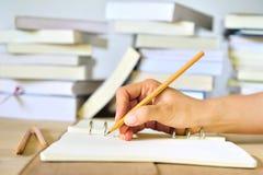 Écrivez sur le livre Images stock