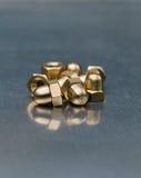 Écrous en laiton hexagonaux Photographie stock