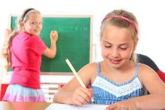 Éducation, écriture de fille sur le tableau noir Photos stock