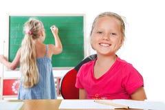 Éducation, écriture de fille sur le tableau noir Images stock