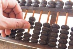 Éducation de finances de vieille calculatrice antique de main et d'ABAQUE rétro, Photos stock
