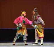 Éducation des aînés--€œLittle Worriors d'opéra de Pékin de  de family†de Yeuh's Photographie stock