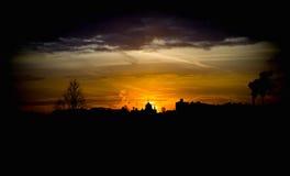 Église du soleil de soirée de coucher du soleil Images stock