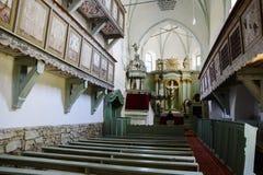Église enrichie médiévale de Bunesti, Bodendorf, la Transylvanie, Roumanie Photographie stock libre de droits