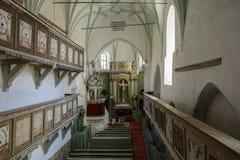 Église enrichie médiévale de Bunesti, Bodendorf, la Transylvanie, Roumanie Photographie stock