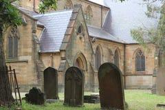 Église historique avec le cimetière Images stock