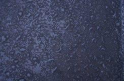 Égouttements de pluie sur une texture Photos stock