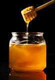 Égoutture de miel Image stock