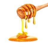 Égoutture de miel images stock