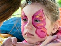 Élève du cours préparatoire d'enfant avec la peinture de visage image stock