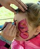 Élève du cours préparatoire d'enfant avec la peinture de visage photos libres de droits