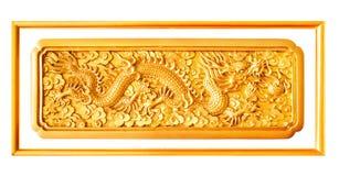 Éléments d'or de décoration de stuc de dragon d'isolement avec le cadre Images stock