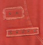 Éléments des jeans oranges Photographie stock libre de droits