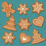 Éléments mignons de pain d'épice sur le fond tricoté illustration stock