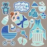 Éléments mignons pour le bébé garçon nouveau-né européen. Photos libres de droits