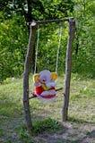 Éléphant de jouet sur la bascule photos stock