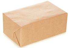 Él hace el paquete a mano de papel fotografía de archivo