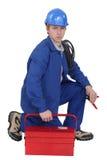 Électricien avec une boîte à outils Photos stock