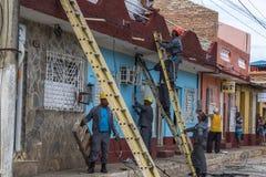 Électriciens au Trinidad Photographie stock libre de droits