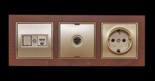Électrique, rj45 et débouché de télévision sur le mur Photos libres de droits