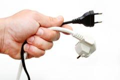 Électrique une prise dans une main Images stock