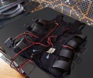 Électro détail de costume de stimulation de SME sur le noir Photo stock