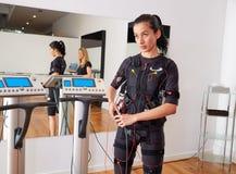 Électro femme de costume de stimulation de SME Photographie stock