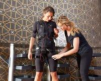 Électro femmes de costume d'entraîneur de stimulation de SME Photo stock
