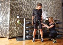Électro femmes de costume d'entraîneur de stimulation de SME Image libre de droits