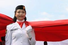 Éleveurs indonésiens de drapeau dans une cérémonie Images libres de droits
