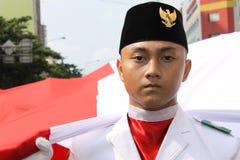 Éleveurs indonésiens de drapeau dans une cérémonie Image stock