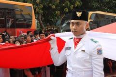 Éleveurs indonésiens de drapeau dans une cérémonie Photographie stock libre de droits