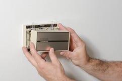 Élimination d'une couverture de thermostat Image libre de droits