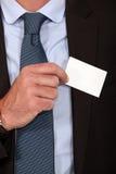Élimination de la carte de visite professionnelle de visite de la poche Photos libres de droits