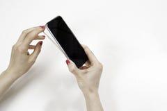 Élimination de la couverture de silicone du smartphone Photographie stock