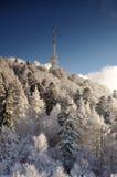 Émetteur Sitno de TV en paysage d'hiver Image libre de droits