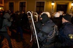 Émeutes et police Image stock