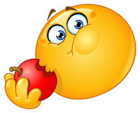 Émoticône mangeant la pomme Image libre de droits