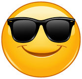 Émoticône de sourire avec des lunettes de soleil Image libre de droits