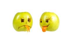 Émoticônes heureuses et tristes des pommes Sentiments, attitudes Photographie stock libre de droits