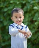 Émotion de sourire toothy de bonheur de visage d'enfants adorables asiatiques, o Image libre de droits