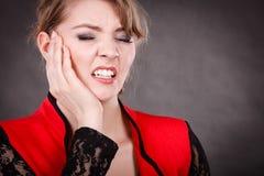 Émotion négative Femme ayant le mal de dent image libre de droits