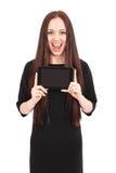 Émotions d'adolescente Fille montrant un écran vide de comprimé Photo stock